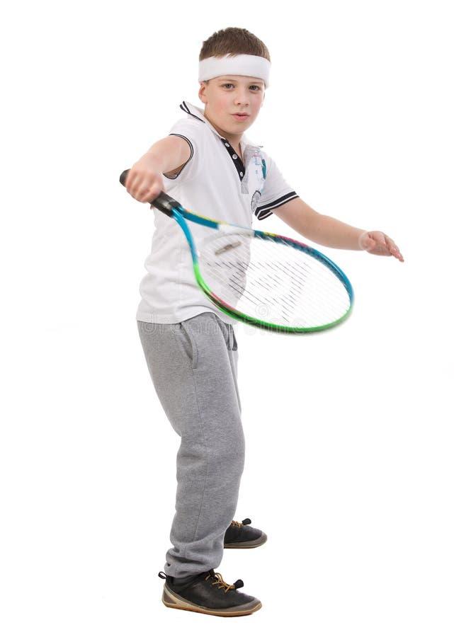 Muchacho que juega a tenis imagen de archivo libre de regalías