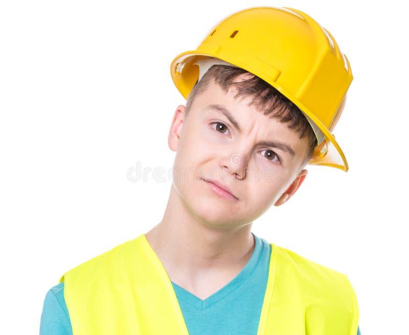 Muchacho que lleva el casco amarillo fotografía de archivo libre de regalías