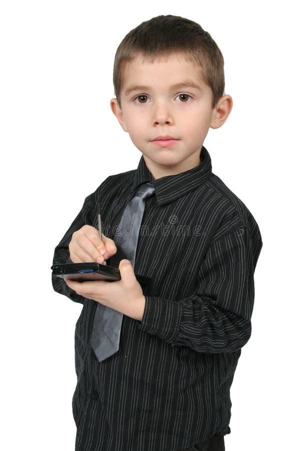 Muchacho que usa PDA imágenes de archivo libres de regalías