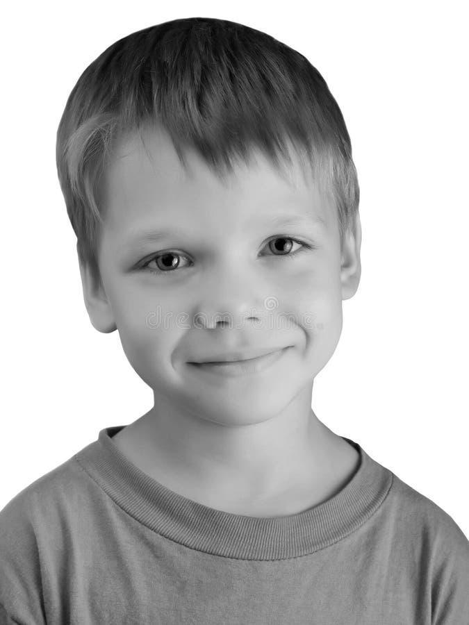 Muchacho sonriente feliz sobre blanco imagenes de archivo