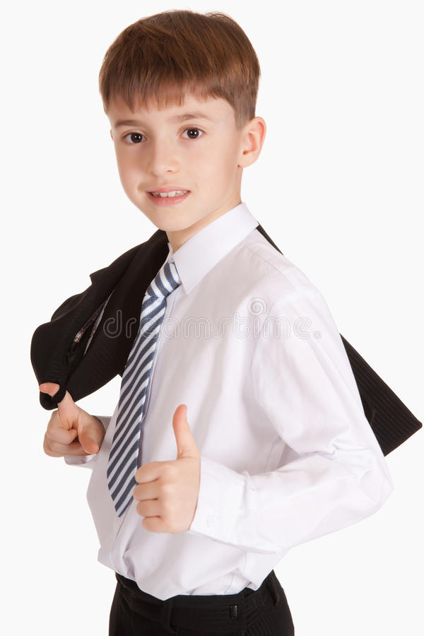 Muchacho vestido en lazo y chaqueta imagen de archivo libre de regalías