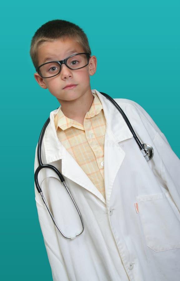 Muchacho vestido encima como de doctor fotografía de archivo