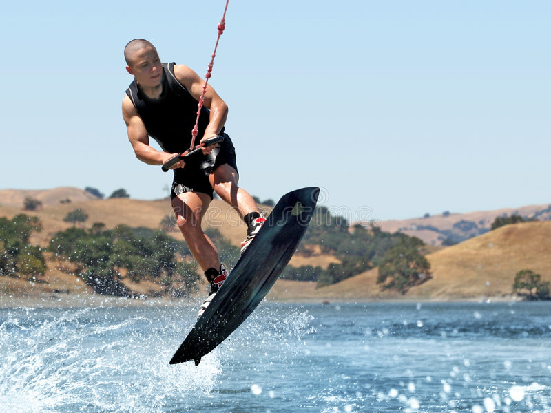 Muchacho Wakeboarding foto de archivo libre de regalías
