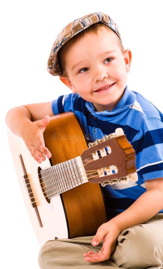 Muchacho y guitarra imágenes de archivo libres de regalías