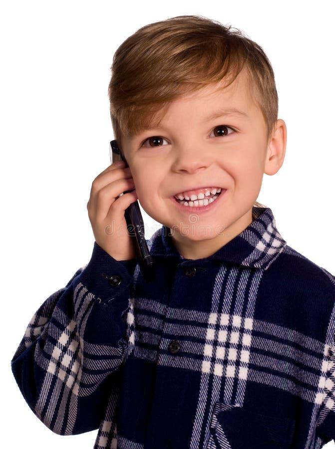 Muchacho y teléfono celular fotos de archivo