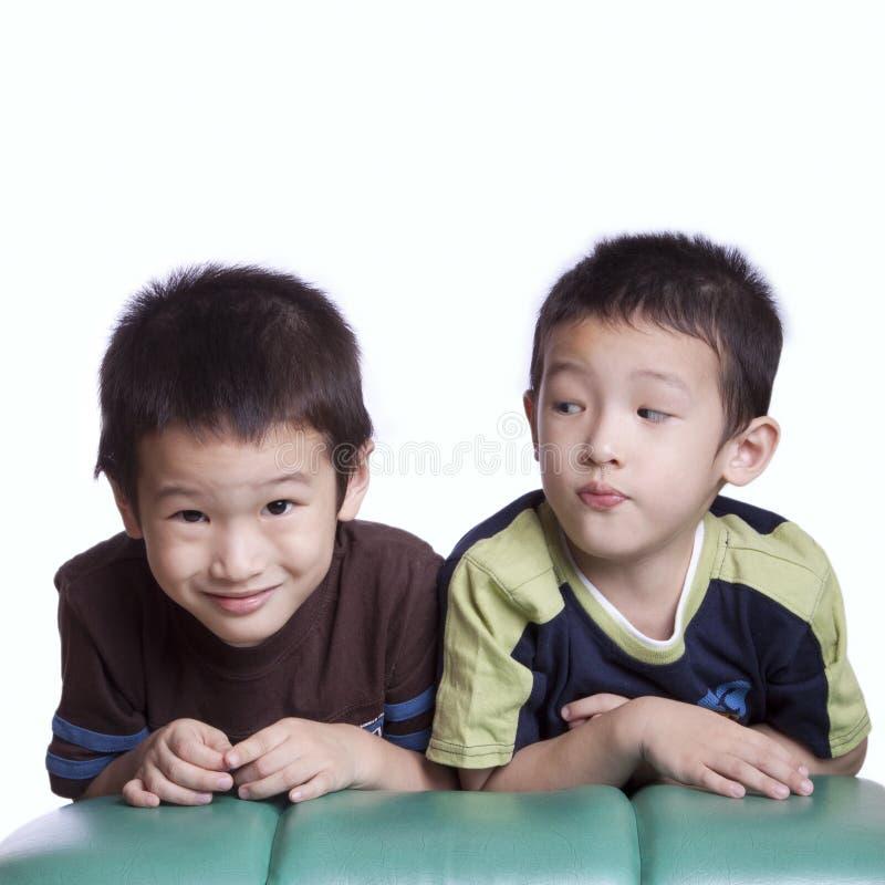 Muchachos asiáticos foto de archivo