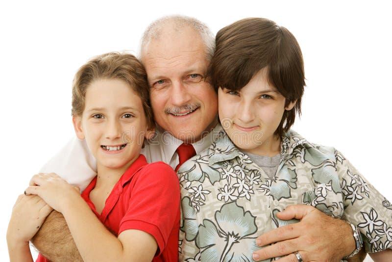 Muchachos y su papá foto de archivo libre de regalías