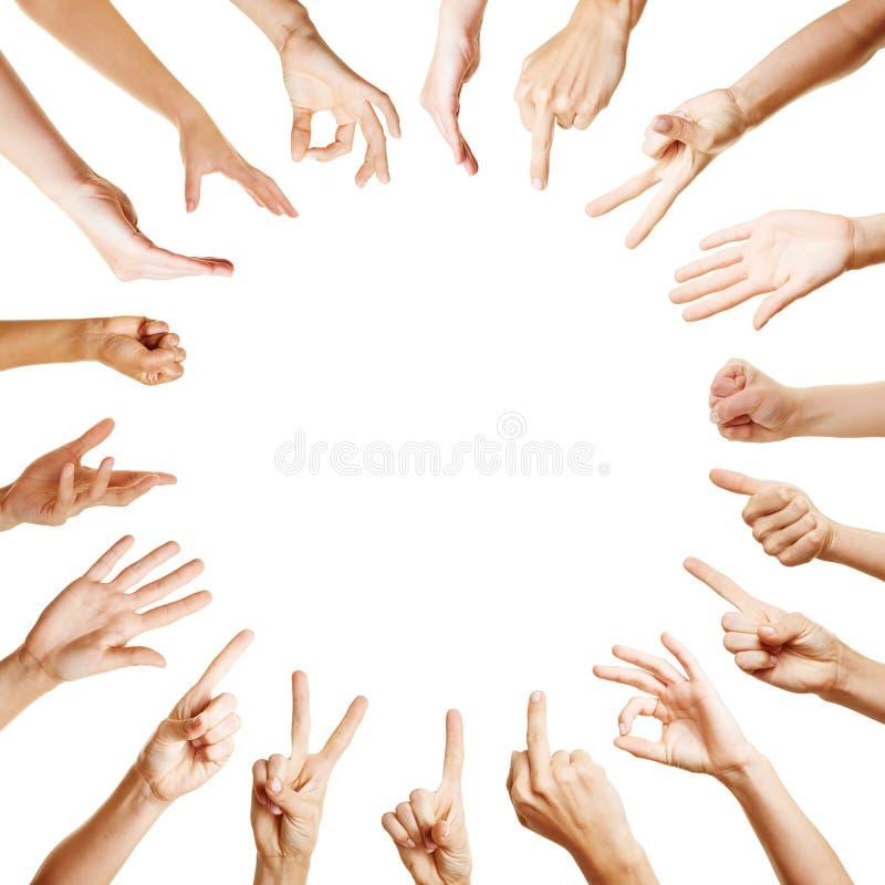 Muchas manos en círculo con diversos gestos fotos de archivo
