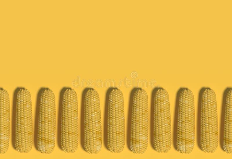 Muchas mazorcas de maíz amarillas mienten en fila en un fondo amarillo Composición decorativa creativa Arte moderno representaci? stock de ilustración