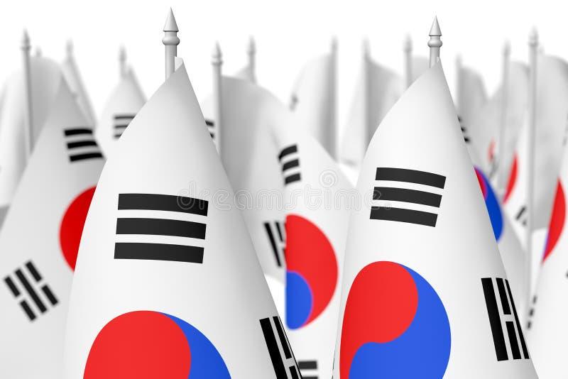 Muchas pequeñas banderas coreanas con el foco selectivo stock de ilustración