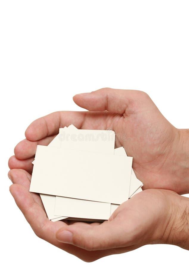 Muchas tarjetas de visita en manos foto de archivo libre de regalías