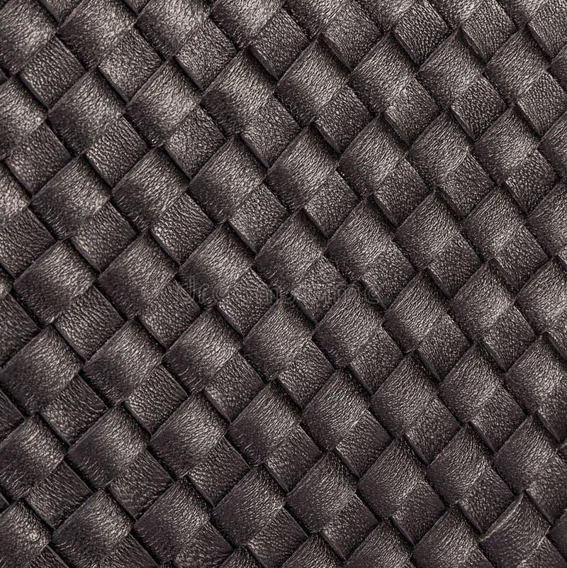 Muchas tiras finas de cuero negro natural fotografía de archivo