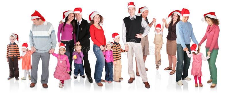 Mucho familia de la Navidad con los niños foto de archivo libre de regalías
