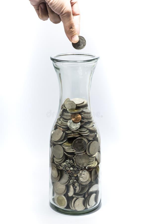 Mucho moneda del baño en la botella foto de archivo