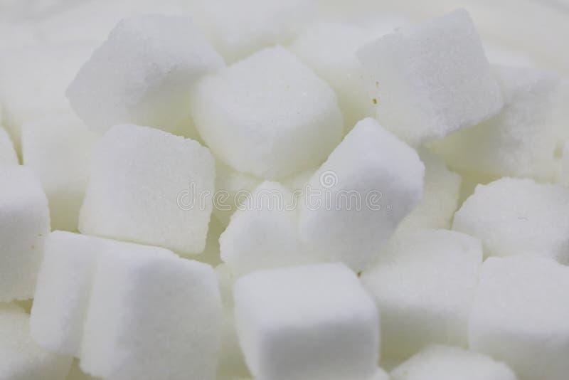 Muchos cubos del azúcar imagen de archivo