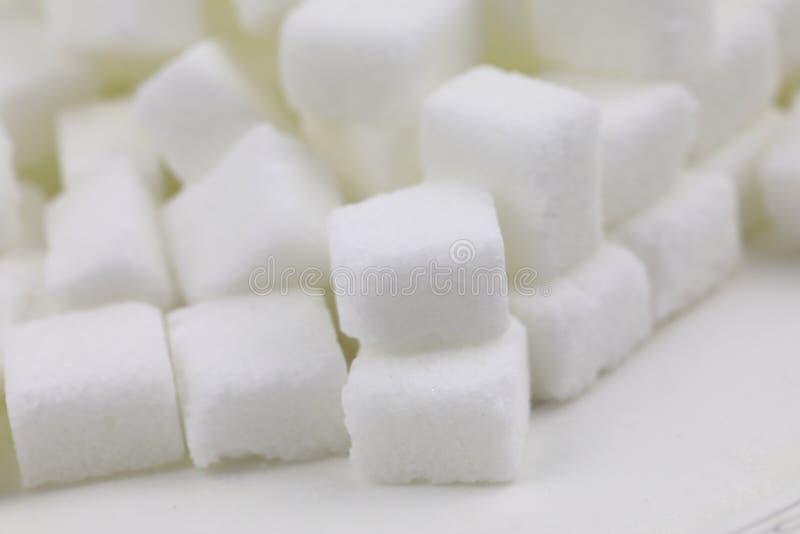 Muchos cubos del azúcar fotos de archivo