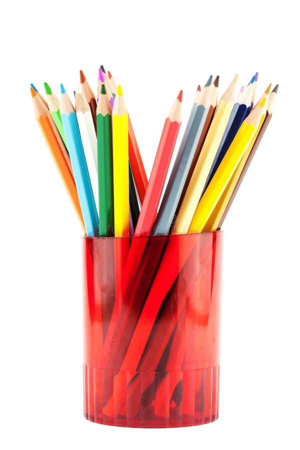 Muchos lápices en taza roja foto de archivo libre de regalías