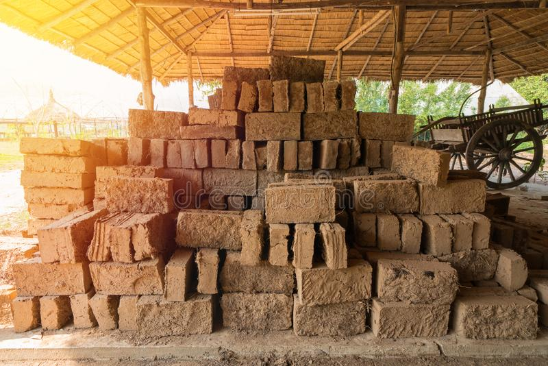 Mud bricks or clay bricks for building clay house.  stock photo