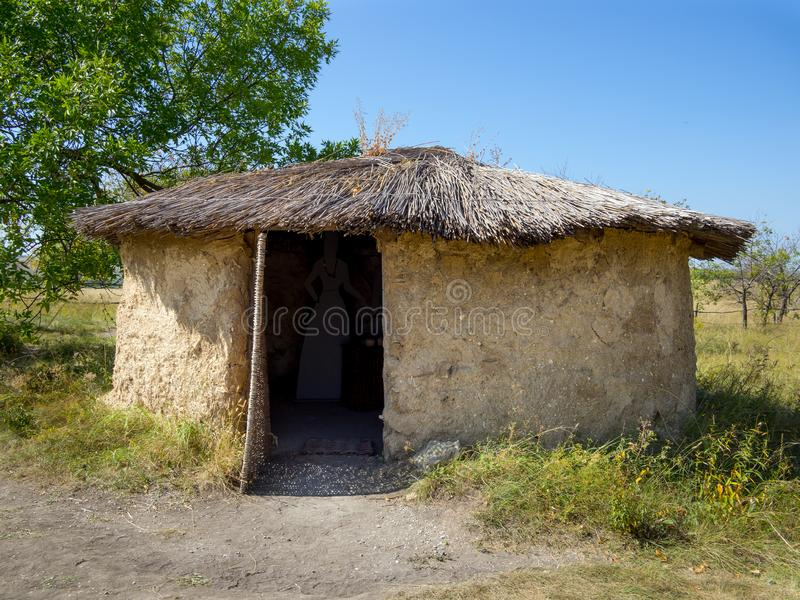 Mud hut with a reed roof stock images