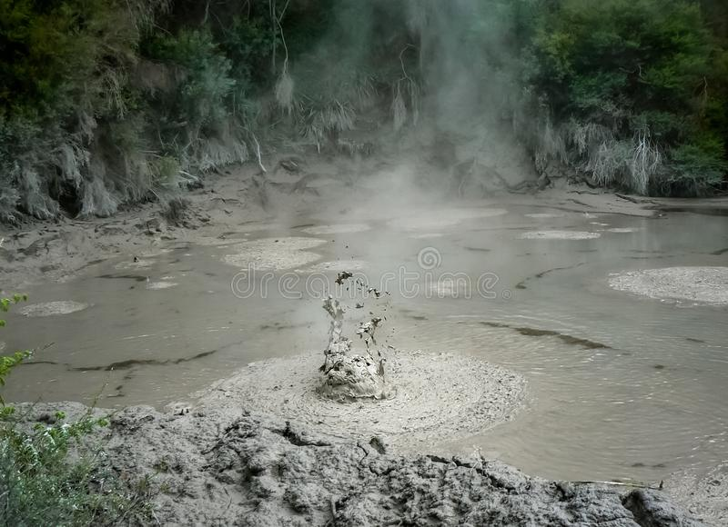 Bubbling, splashing and boiling mud pool, Rotorua, New Zealand. Mud pool bubbling, splashing and boiling, Rotorua, North Island, New Zealand royalty free stock photos