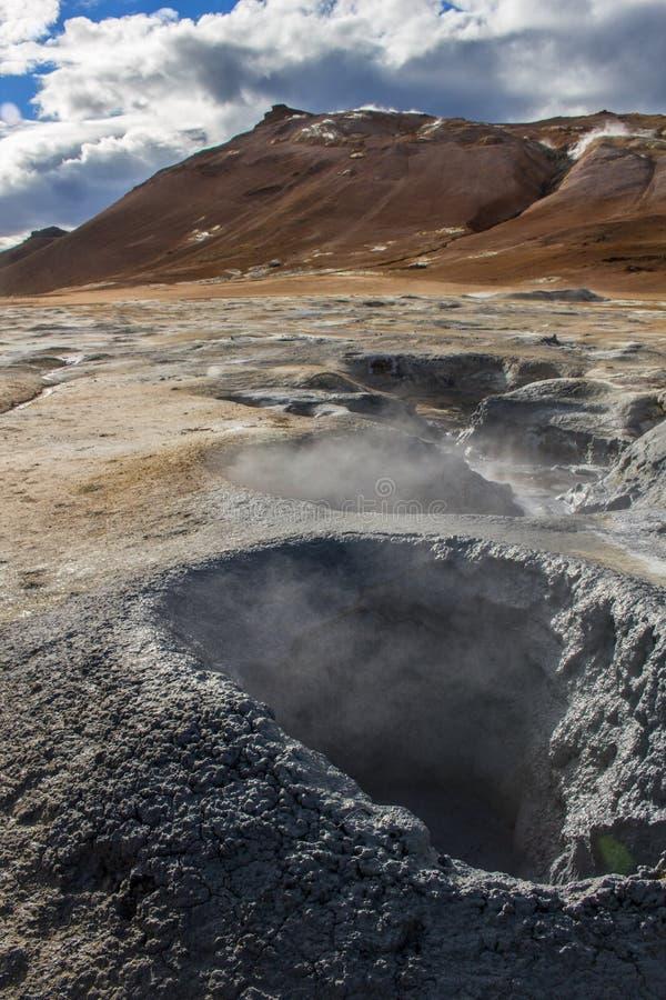 Mud pot at geothermal / volcanic area. Mud pot at the geothermal / volcanic area Hverarönd Hverir at Lake Myvatn Region, Iceland stock photos