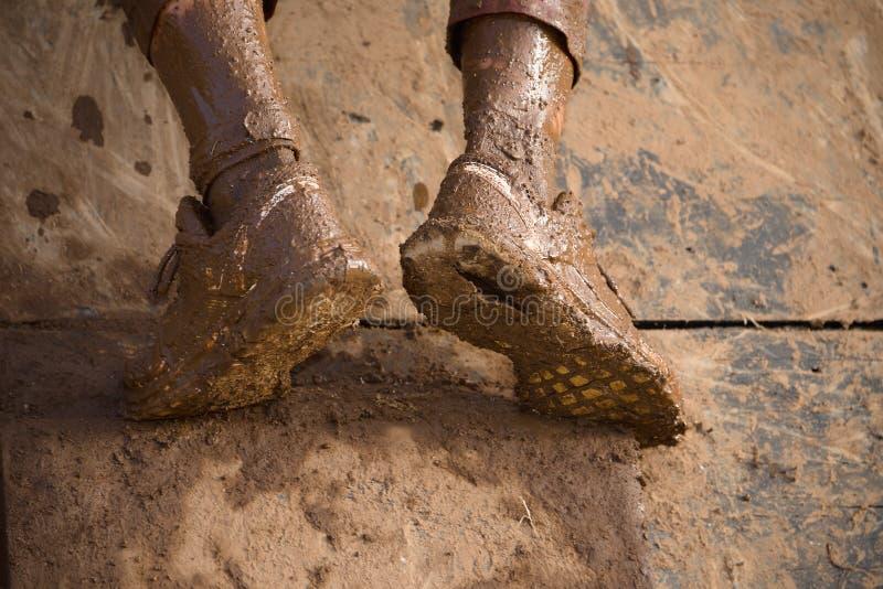 Mud race runners stock image