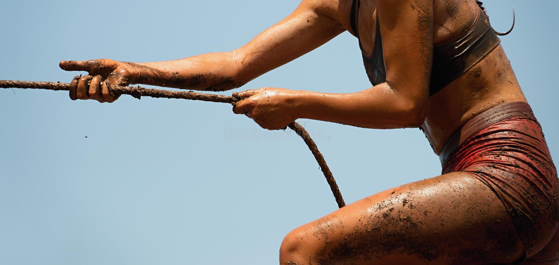 Mud race runners royalty free stock photo