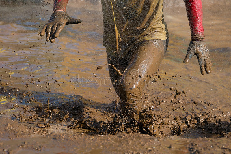 Mud race runners royalty free stock photography