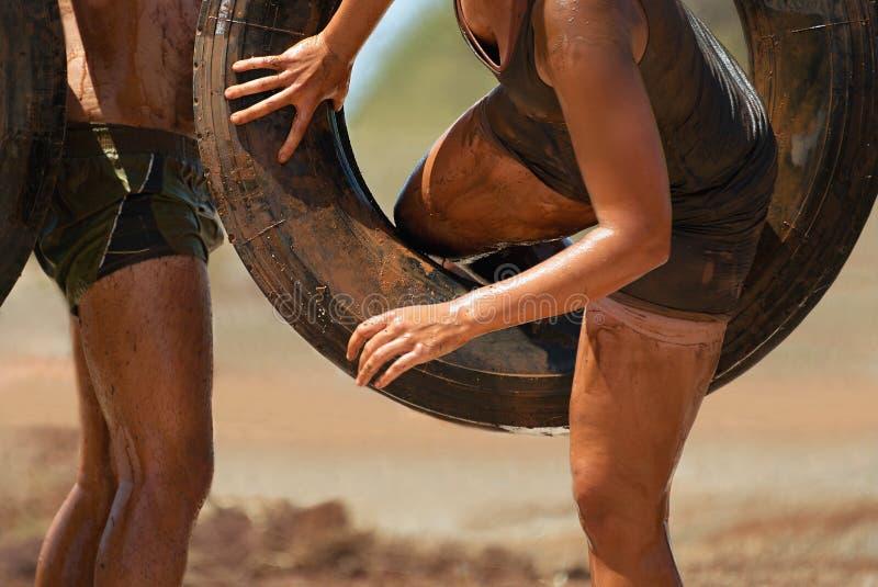 Mud race runners stock photo