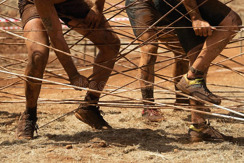 Mud race runners stock images