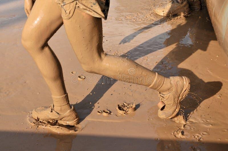 Mud running royalty free stock photography