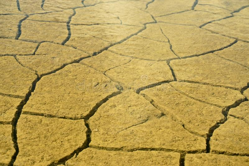 Mud Texture. Cracked mud under water in a pool on the salt marsh due to hot dry weather royalty free stock photo