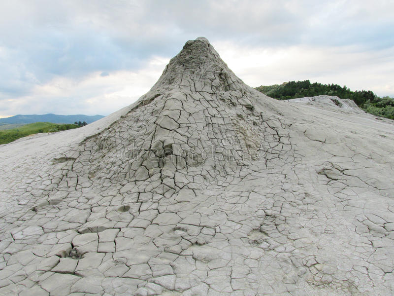 Mud volcano erupting with dirt stock photos