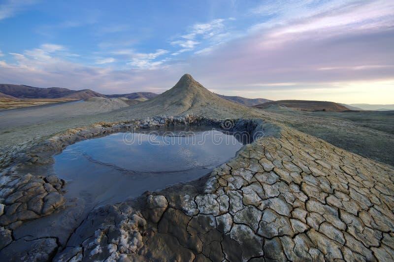 Bubbling mud. Mud volcano landscape at sunset - landmark attraction in Buzau, Romania stock photo