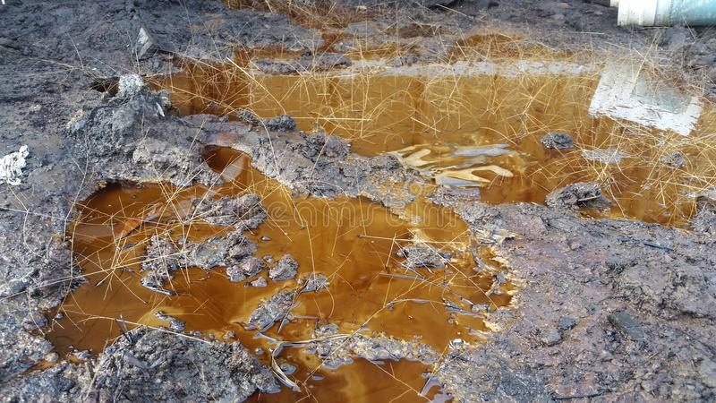 Muddle. Oil spilled out of machinery stock photos