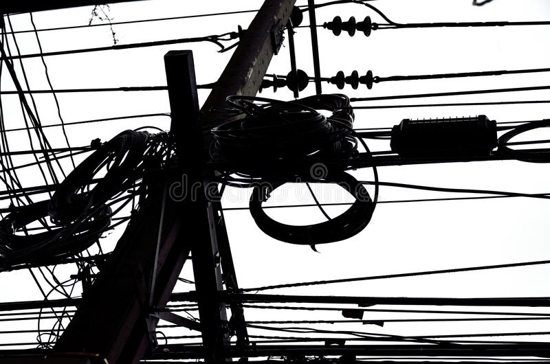 Muddle wire on electrictity post. In Thailand stock images