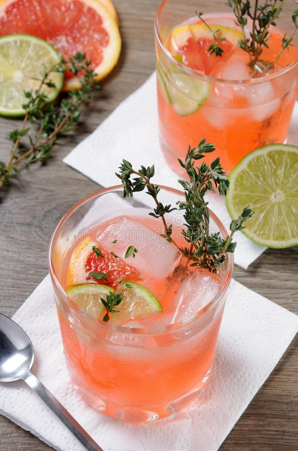 This Grapefruit and Thyme Bourbon. Muddled lime and thyme, combined with fresh grapefruit juice and delicious bourbon, it's the perfect way to get the stock photos