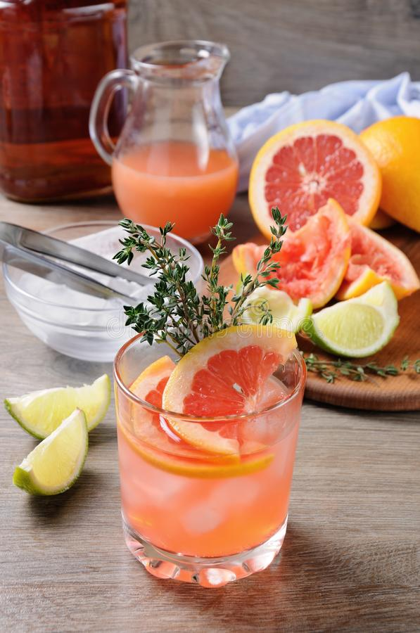 This Grapefruit and Thyme Bourbon. Muddled lime and thyme, combined with fresh grapefruit juice and delicious bourbon, it's the perfect way to get the royalty free stock photos