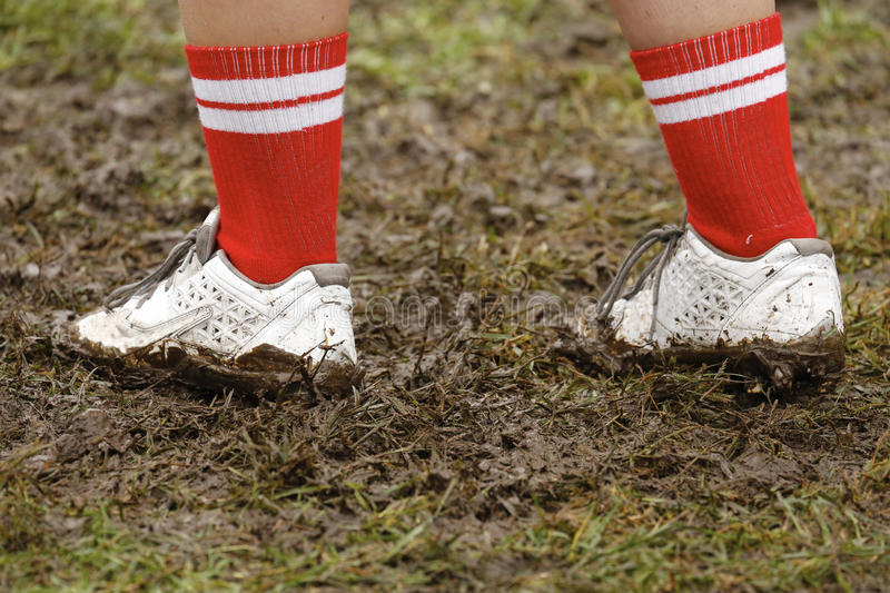 Muddy Cleats. Cleats digging into the muddy ground royalty free stock photography