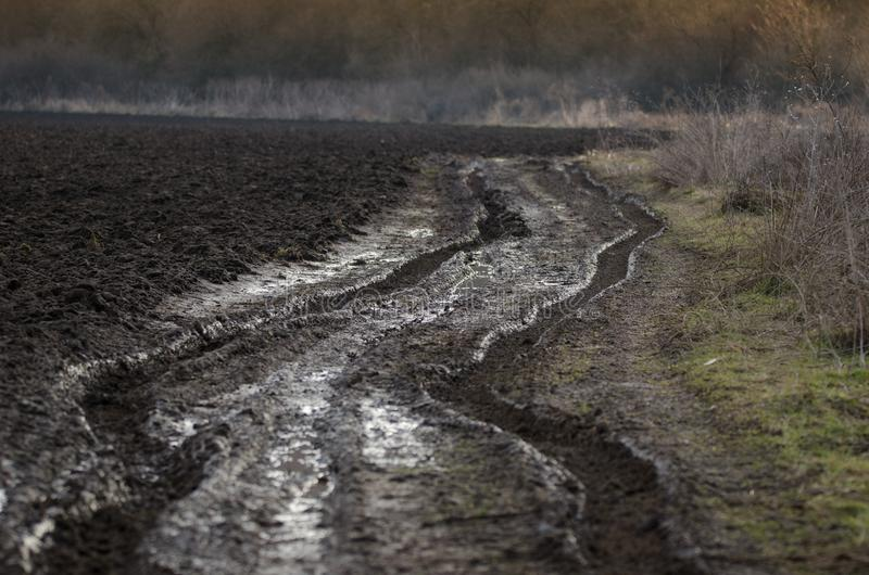 Muddy countryside road royalty free stock photo