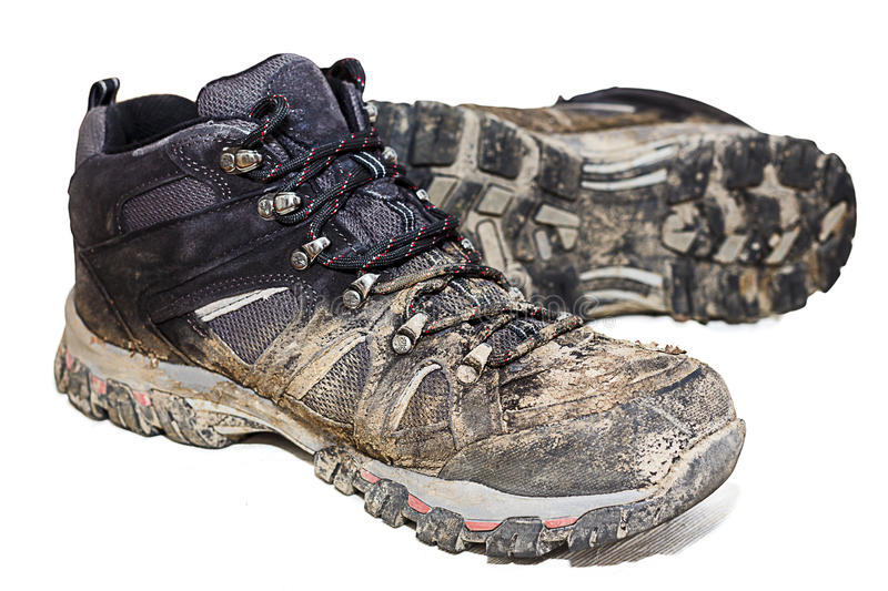 Muddy Hiking Boots Isloated imagem de stock royalty free