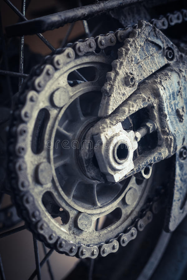 Muddy motorcycle chain stock image