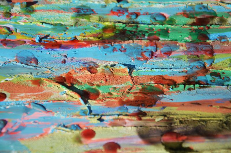 Muddy paint, watercolor hues, spots, abstract background. Muddy spots, wax, paint, watercolor hues, colorful abstract background in red, orange, blue, green stock photography