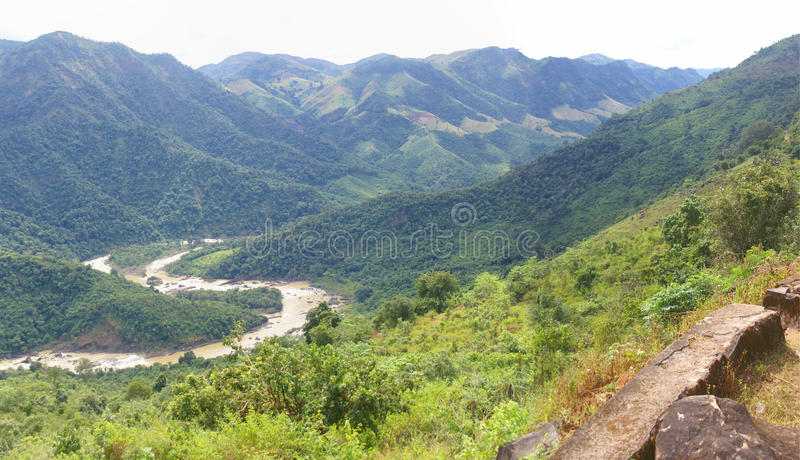 Muddy river meanders through jungle hills, of Ori stock photo