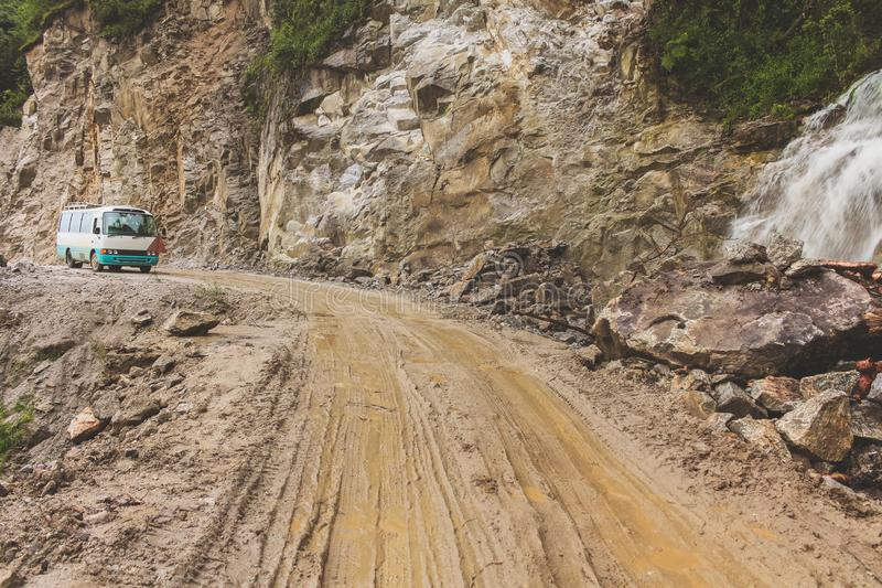 Muddy road and the bus on the way to Punakha to Trongsa. stock photo