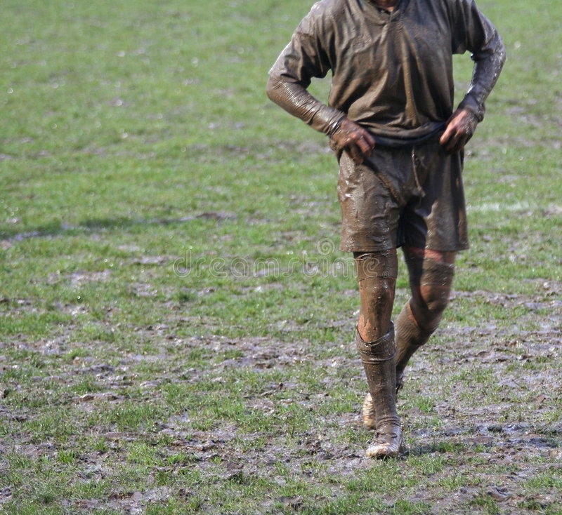 Muddy rugby player stock image