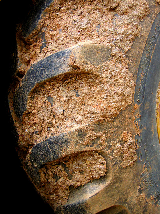 Muddy Tractor Tire royalty free stock images
