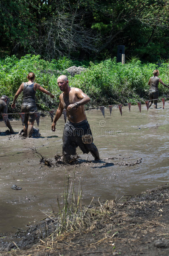 Download Muddy waters and teams editorial stock photo. Image of challenge - 25854533