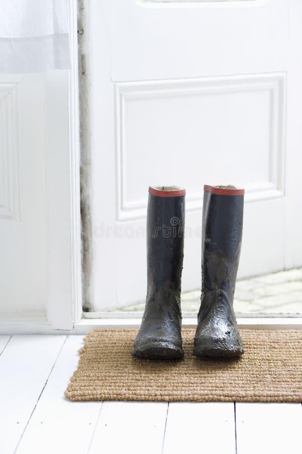 Muddy Wellington Boots fotografía de archivo