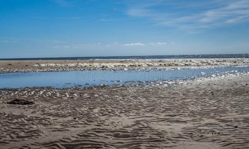 Mudflat along the Dutch coast. Mudflat along the shore of the Frisian Wadden island of Ameland, Netherlands stock photos